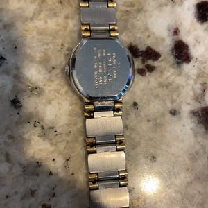 Silver and gold Seiko watch
